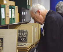 A visitor to the EA Archives during a reunion event